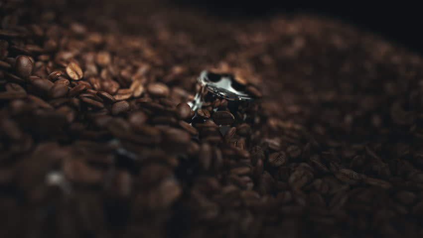 Coffee beans in the grinder. Two high quality videos of coffee beans in the grinder. Super slow motion video. #23960947