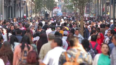 Mexico City, Mexico-CIRCA June,2017 TAKE 2: Crowd walking through street. In Mexico the populatIon growing is a public problem due the high birth rates.