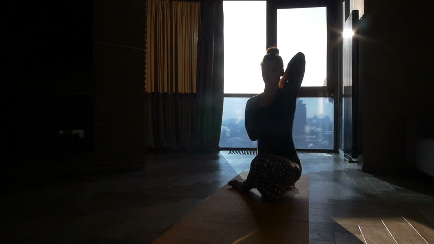Fitness girl yoga silhouette in the room | Shutterstock HD Video #23987089
