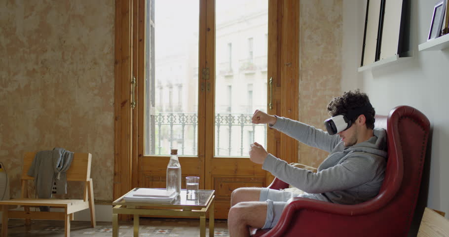 Man wearing virtual reality headset playing game 360 video immersive concept at home | Shutterstock HD Video #23992561
