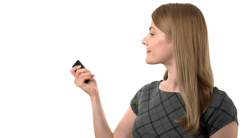 Beautiful young businesswoman in grey dress making presentation with laser pointer. Silly behavior   Shutterstock HD Video #23999479