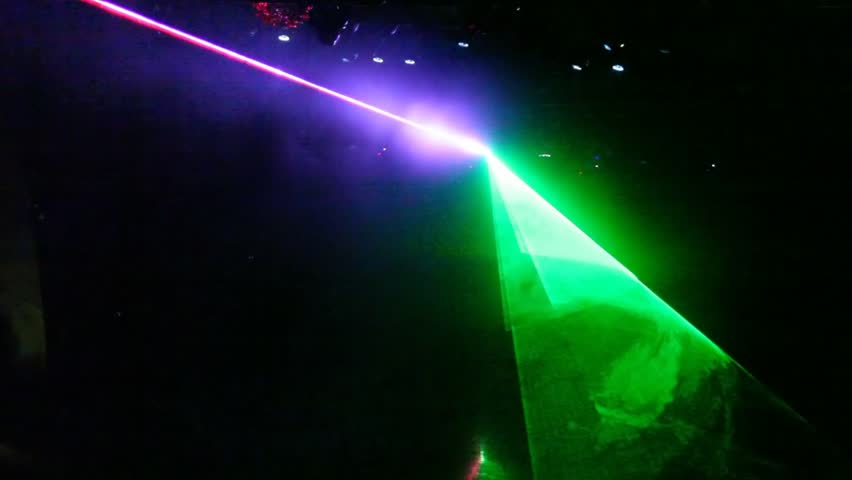 laser show from multi-colored rays of light in dark in disco. warning, laser beams dangerous for camera sensor