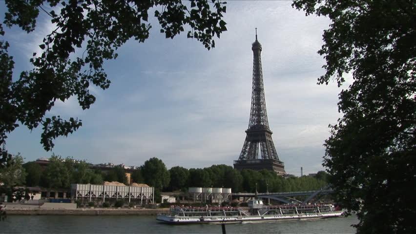 View of Debilly Footbridge and Eiffel Tower in Paris France framed in trees