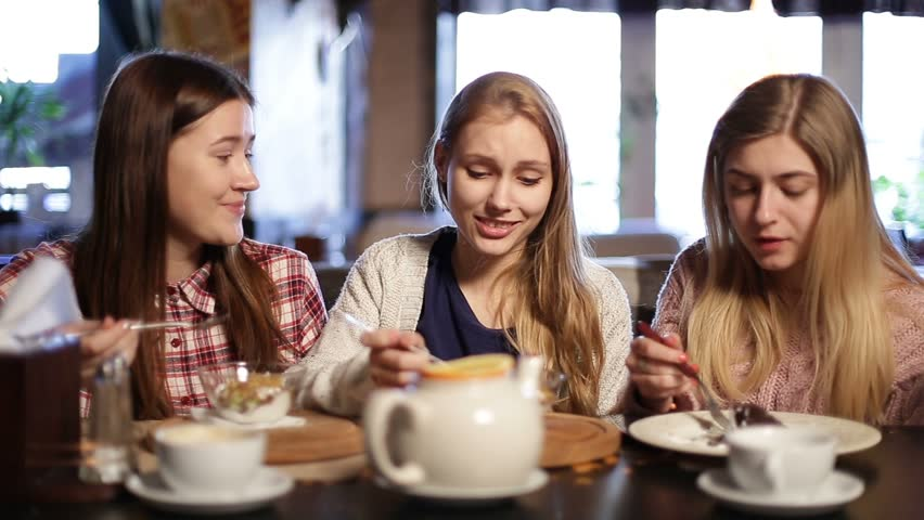 Attractive girlfriends chilling out at restaurant | Shutterstock HD Video #24022249