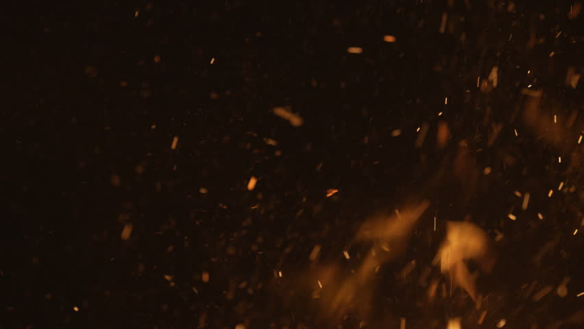 A lot of bright sparks are flying from the fire at night | Shutterstock HD Video #24045199