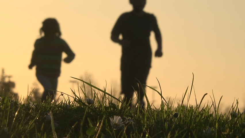 Blurry silhouette of kids running at sunset | Shutterstock HD Video #24055339