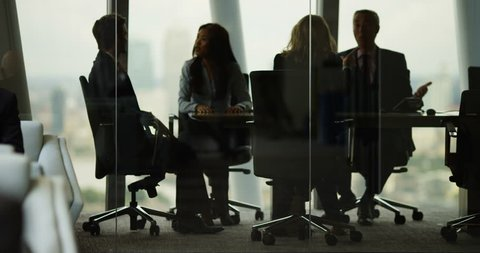4K Corporate business team arguing in boardroom meeting in city office. Slow motion.