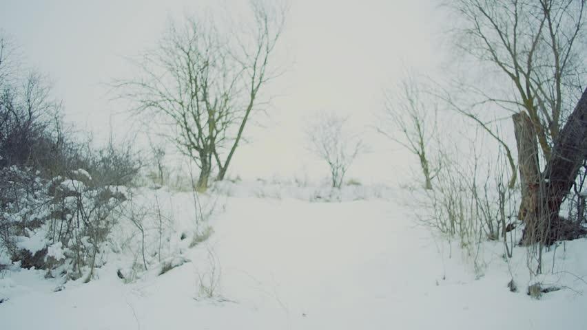 Slow motion. snow winter landscape run men with backpack | Shutterstock HD Video #24078979