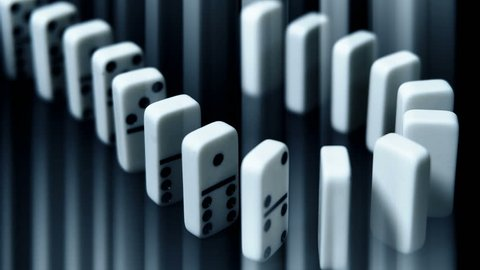 built figure of dominoes falling in slow motion