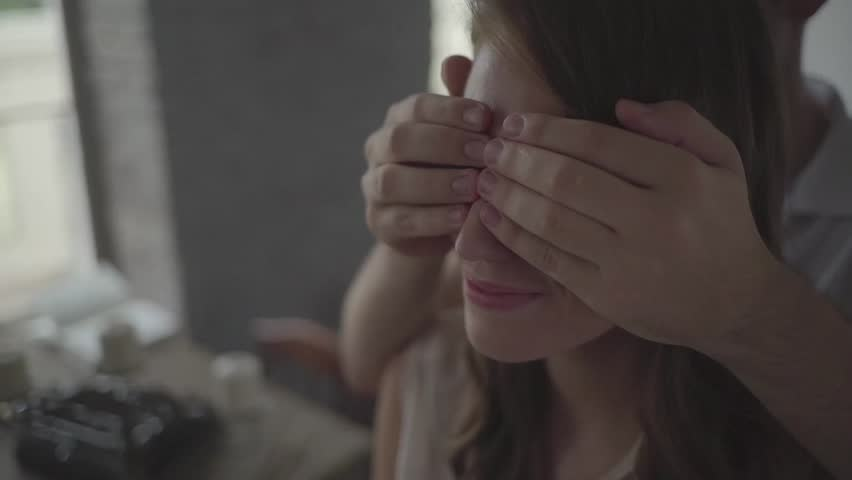 Man closes his is girlfriend's eyes to make surprise. | Shutterstock HD Video #24102649