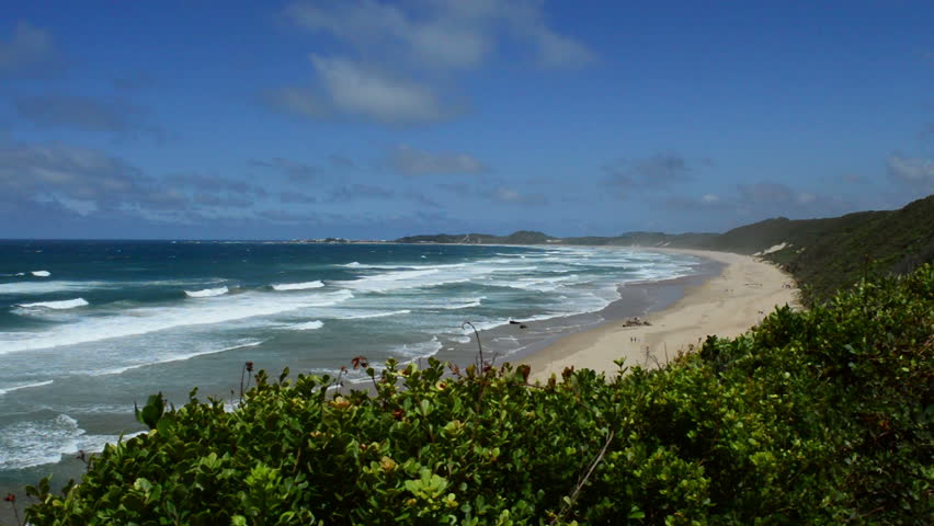 View of the long curved beach of Buffelsbaai or Buffalo Bay located in Knysna, South Africa.