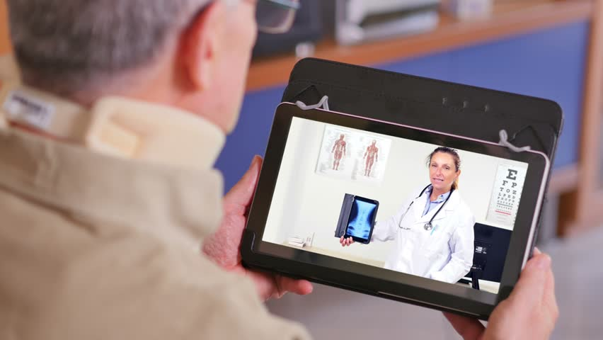 doctor video chat on tablet showing neck x-rays to patient