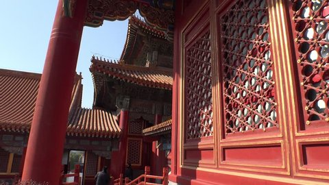 Forbidden city Beijing capital of China. Emperor palace red internal garden. Old Asian culture. Beautiful summer day, Blue sky. Cinematic