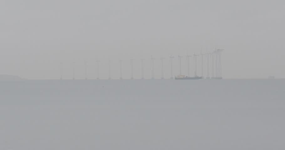 Large industrial boat near Oresund strait which forms the DanisH-Swedish border - Offshore wind farm Lillgrund in the Oresund between Malmo Sweden and Copenhagen DenmarK   Shutterstock HD Video #24165589