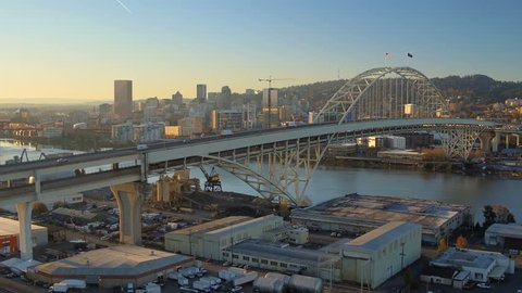 Portland Aerial v63 Flying low over Fremont Bridge panning with cityscape views at sunrise.