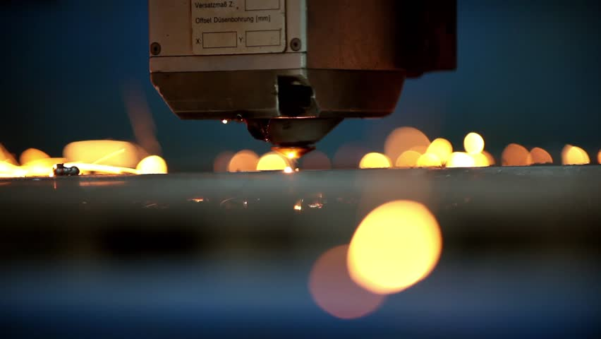 Industrial robotic laser cutter cuts metal parts with great precision