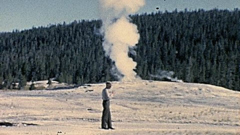 YELLOWSTONE NATIONAL PARK - 1965: ranger talk in front a geyser in 1965 Yellowstone National Park
