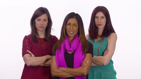 Three female bullies point and laugh. Medium shot on white background.