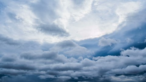 Storm clouds moving dark sky timelapse. Dramatic stormy weather background time lapse. Danger thunderstorm cloudscape nature. Gray, black rain overcast cloudy, moody climate scene. Ominous wind heaven