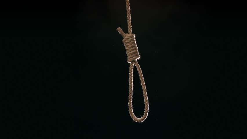 Hangmans noose falling into frame at 120 fps against black background