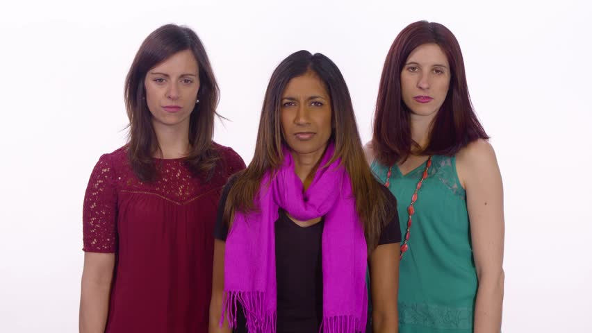 Three woman bully the viewer. Medium shot on white background.
