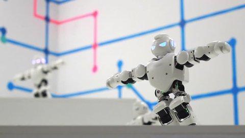 Robots man dancing. Dancing robot close up. Smart technology concept. Closeup of smart robots dance. Robotic dance party. Dancing robot humanoid. Dancer robot man