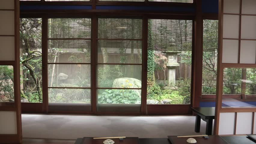Traditional Japanese Indoor Decoration With Sliding Doors And Tatami