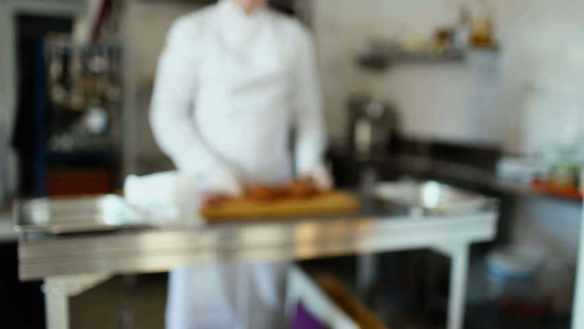 Restaurant Kitchen Chefs motion chefs of a restaurant kitchen stock footage video 7008400
