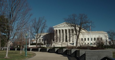US Supreme Court Very Wide Through Trees Blue Sky winter scene.