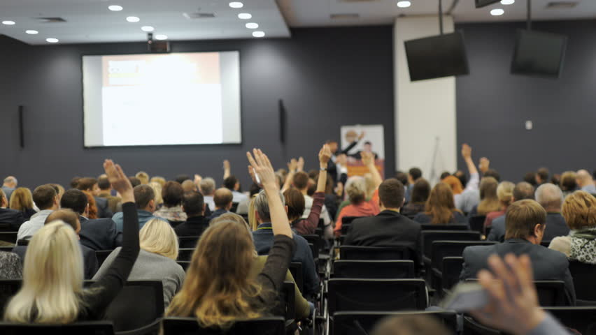 Business people Raising there Hand Up at a Conference to answer a question 4k. | Shutterstock HD Video #24275558