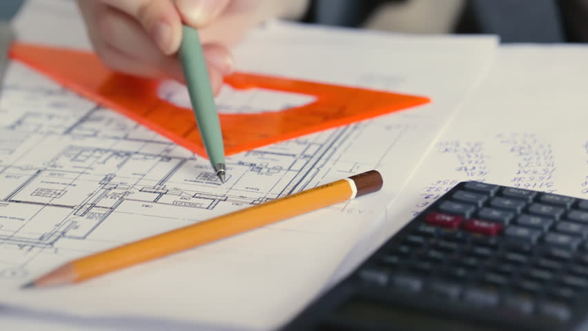 Top above view of architect architecture drawing project blueprint architect with blueprint and calculator estimating project cost hd stock footage clip malvernweather Gallery