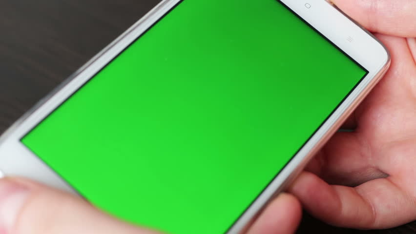 Touch Screen On White Smartphone Green Screen.Close up view. Using Smartphone,Holding Smartphone with Green Screen #24309359
