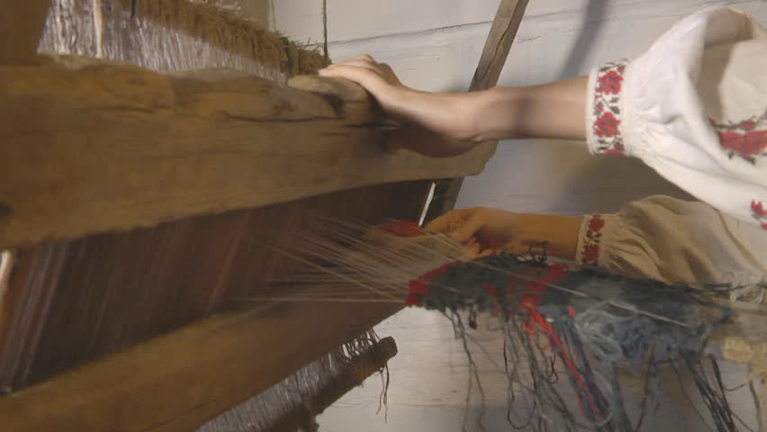 Old Turkish Woman Trimming Wool On Carpet While Weaving