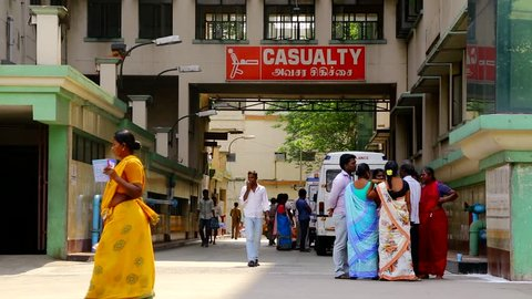 CHENNAI, INDIA - SEPTEMBER 18th, 2015: patients seeking medical treatment waiting, Exterior shot casualty parking two ambulance