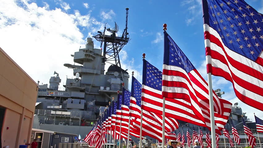 HONOLULU, OAHU, HAWAII, USA - AUGUST 21, 2016: Battleship Missouri Memorial with American flags at Pearl Harbor in Honolulu Hawaii, Oahu island of United States. National historic patriotic landmark.