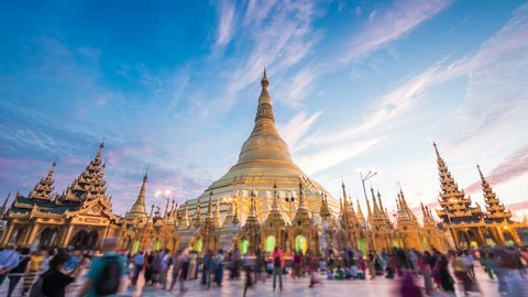 Shwedagon Pagoda, time lapse view of famous Buddhist landmark at sunset in Yangon, Myanmar (Burma).
