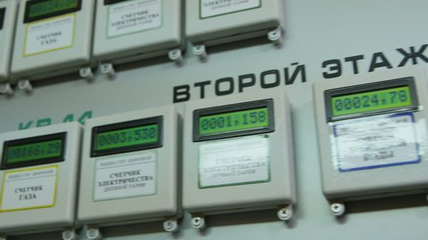 closeup motion along modern automatic meters in stairwell apartment house show gas electricity heating water data