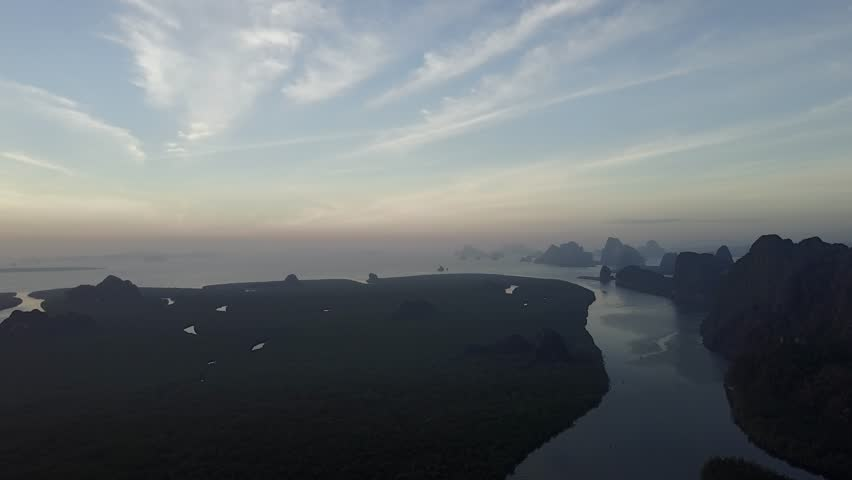 Aerial cinematic view of  Mangrove swamps in Phang Nga Bay National Park (Ao Phangnga) on sunrise background, Phang Nga Province, southern Thailand
