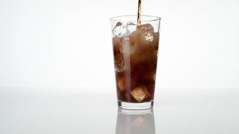 Pouring soda into glass. Shot with high speed camera, phantom flex 4K. Slow Motion.