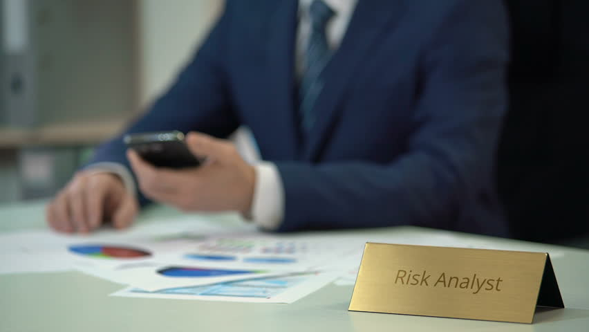 expert risk analyst using mobile app checking market statistics in diagrams stock footage video 24505169 shutterstock