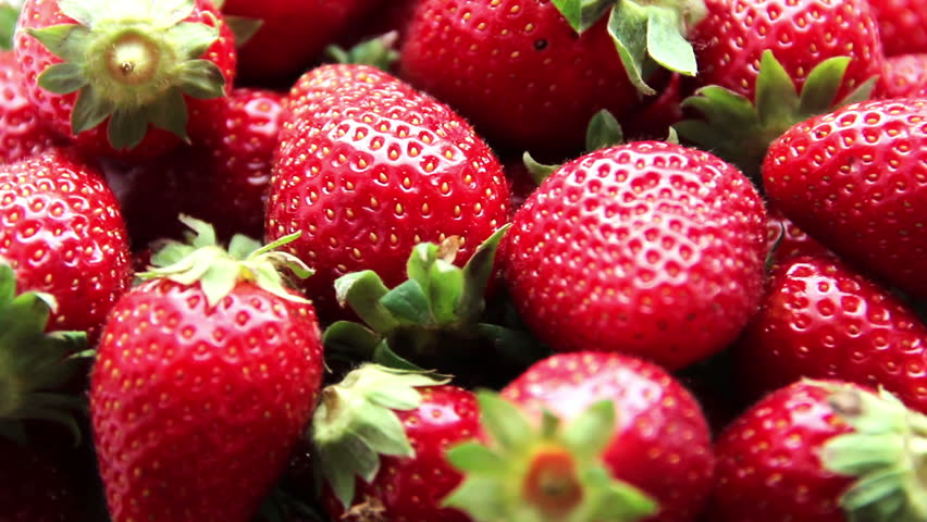 Fresh, ripe, juicy strawberries rotate. Red strawberries clockwise rotation