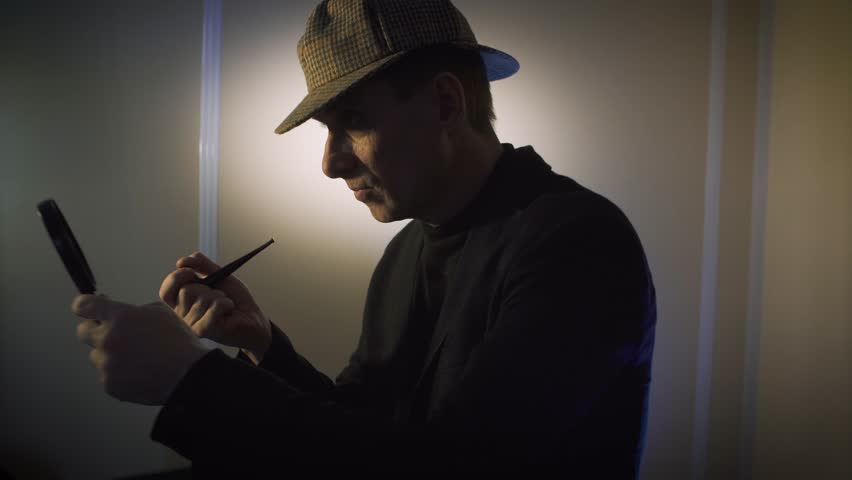 640c22e04513b sherlock holmes in studio detective at work with magnifying glass and pipe