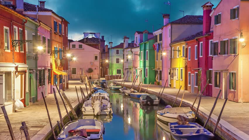 Canal and colorful houses in the evening on Burano Island, Venice, Italy (static image with animated sky and water)