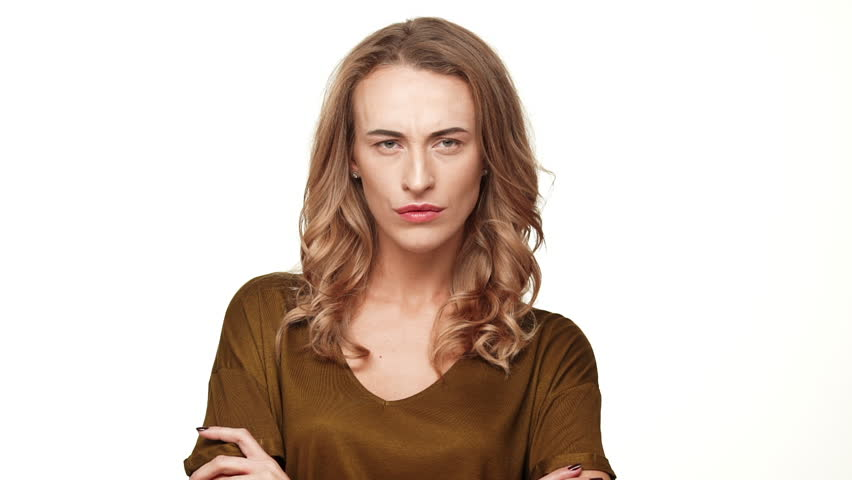 Displeased beautiful middle-aged female with long brown hair looking at camera gesturing on white background in slowmotion | Shutterstock HD Video #24543719