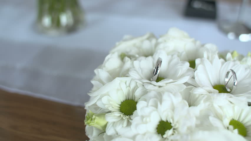 Stock video of flower decorations on the wedding tables 2266226 hd0005wedding rings on white flowers mightylinksfo