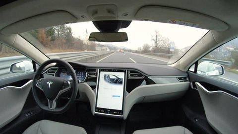 LINZ, AUSTRIA - FEBRUARY 2nd 2017: Fully autonomous self-driving autopilot Tesla Model S driverless car with next gen ultrasonic sensors, cameras and radars driving along the highway in heavy traffic