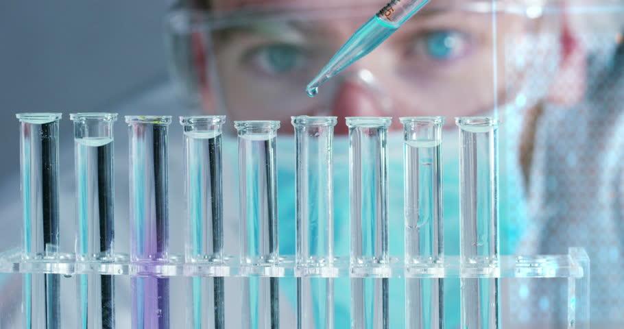 In a futuristic laboratory, a scientist with a pipette analyzes a colored liquid to extract the DNA and molecules in the test tubes.Concept:research,biochemistry,immersive technology,augmented reality | Shutterstock HD Video #24564902