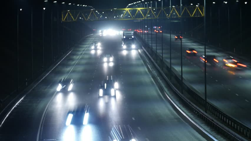 Long Exposure Time Lapse of Western Bypass Night Traffic in Vilnius, Lithuania. High-angle view from a bridge. The focus in the foreground. | Shutterstock HD Video #24565559