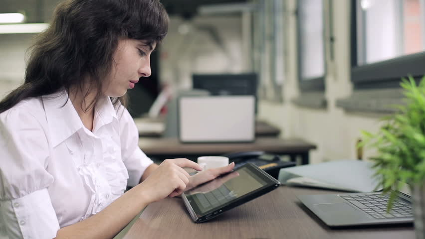 Young businesswoman working on tablet computer in the office  | Shutterstock HD Video #2460329