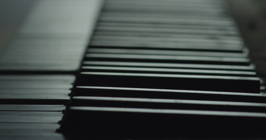 Piano Keyboard keys playing without player. Black and White, slow motion #24614129